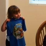 Ella shows off her Dinosaur T-shirt