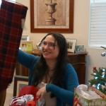 Mary Beth reacts to her new plaid scarf